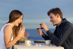 Boyfriend requesting hand of his girlfriend with a engagement ring Royalty Free Stock Photo