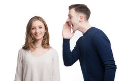 Boyfriend screaming something to his girlfriend. Portrait of smiling women looking at camera while her boyfriend screaming something Royalty Free Stock Photography