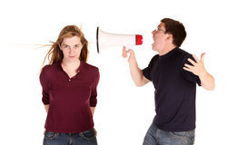 Boyfriend shouting at the girl, but she doesn't seem to care much about him Royalty Free Stock Photography