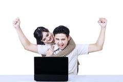 Boyfriend shouting looking at laptop - isolated Royalty Free Stock Images