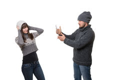 Boyfriend taking picture of his girlfriend Stock Images