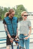 boyfriend with tattoos and stylish girlfriend stock images