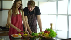 Boyfriend teach girlfriend how to cook spending fun and happy quality time. 4k stock video footage