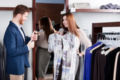 Man thumbs up when his girlfriend tries the dress on Stock Images