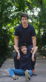 Boyfriend try to lift his girlfriend up from ground for pre wedding shooting stock photos