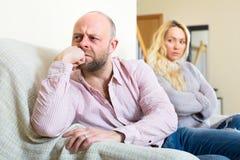Boyfriend turned away from girlfriend Stock Image