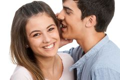 Boyfriend whispering secrets to girlfriend. Stock Photo