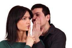 Boyfriend whispers a secret Royalty Free Stock Image