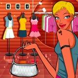 Boyish girl shopping in dresses shop Stock Images