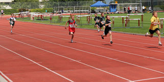 Boys on the 100 meters dash Royalty Free Stock Photography