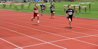 Boys on the 100 meters dash Royalty Free Stock Photos