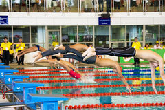Boys 100 Meters Freestyle Swimming Action. Image of boys (13-14 years old) competing in the 100 meters freestyle event at the 33rd South-East Asia Age Group Royalty Free Stock Photography