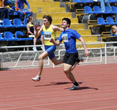 Boys on the 100 meters race Royalty Free Stock Image