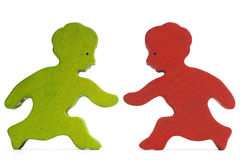 Boys. Two wooden boys - green and red  - running towards each other Royalty Free Stock Images