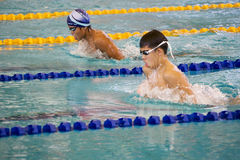 Boys 200 Meters Breaststroke Swimming Action. Image of boys (13-14 years old) competing in the 200 meters breaststroke event at the 33rd South-East Asia Age Stock Photo