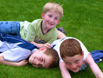 Boys. A photograph of three boys playing in summer stock images