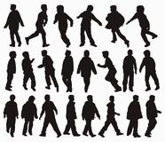 Boys in action. Vector silhouettes of boys in action Stock Images