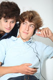 Boys addicted to music Stock Photography
