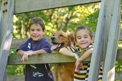 Boys And Dog Royalty Free Stock Photos