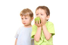 Boys and apple Royalty Free Stock Image