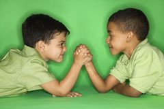 Boys arm wrestling. Royalty Free Stock Image