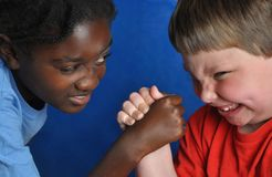 Boys arm-wrestling Royalty Free Stock Photo