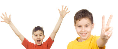 Boys with arms in the air. Letting out a victory yell royalty free stock photography