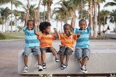 Boys with arms outstretched. Four handsome young boys with arms outstretched in the air stock photos