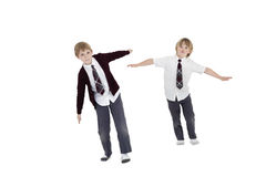 Boys with arms outstretched over white background Stock Images