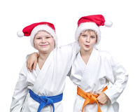 Boys athletes in caps of Santa Claus Stock Photography