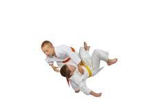 Boys athletes train judo throw Stock Image