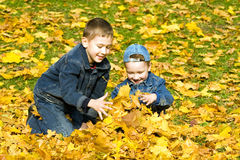 The boys in autumn park Stock Images