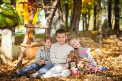 Boys in the autumn park. Two boys sitting on a big pumpkin in the autumn park Royalty Free Stock Images