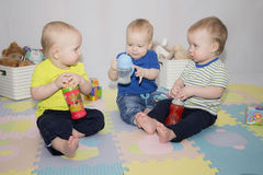 3 boys with baby water bottles royalty free stock image