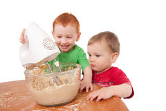 Boys baking cookies with electric mixer Royalty Free Stock Photography