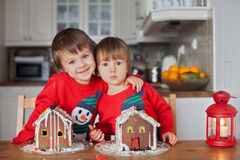 Boys, baking ginger cookies for Christmas Royalty Free Stock Photo