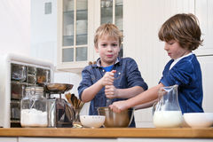 Boys baking pastry Royalty Free Stock Photos