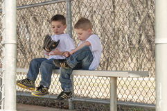 Two Boys sitting on the bench Stock Photography