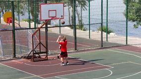 Boys on a basketball court stock video footage