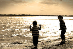 Boys on beach. Two brothers playing at a UK beach Stock Images