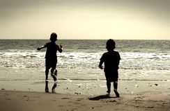 Boys on beach. Two brothers playing at a UK beach Royalty Free Stock Photo