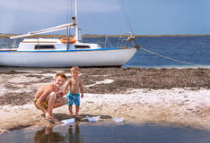 Boys are at the beach. royalty free stock image