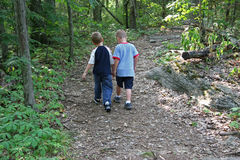 Boys Being Friends. Two five year old boys walking along wooded trail. Shot with Canon 20D Stock Images