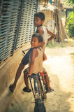 Boys on bicycle in Nepal Royalty Free Stock Photos