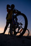 Boys on a bicycles. In the sunset Stock Photo