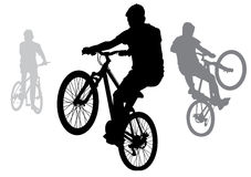 Boys on bicycles. The boys went for a walk on the bike. Teenagers doing tricks on bikes. Silhouette on a white background Stock Photography