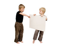 Boys and a blank sign. Stock Photo