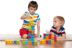 Boys with blocks on the floor Stock Photo