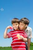 Boys blowing bubbles Stock Photos