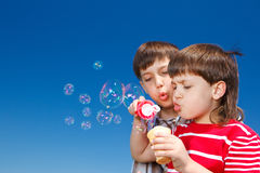 Boys blowing bubbles Stock Image